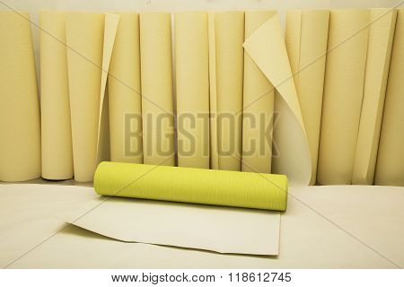 Rolls of wallpaper of two colors ready for applying