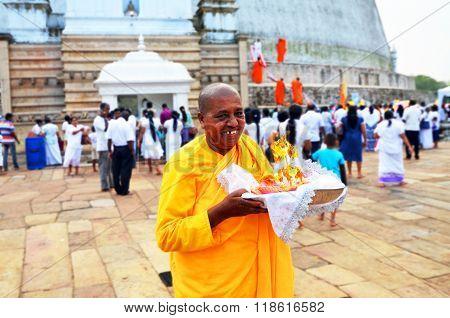 Sri-Lanka Anuradhapura December 30 2015- Buddhist monk near the budda temple (dacoba)