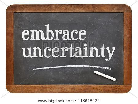 embrace uncertainty sign - white chalk text on a vintage slate blackboard poster