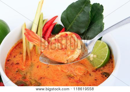 Thai Prawn Soup with Lemongrass (Tom Yum Goong) with Spoon on White Background.