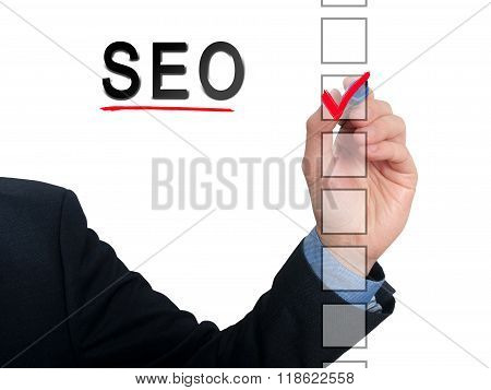 Businessman Checking Mark On Checklist Marker