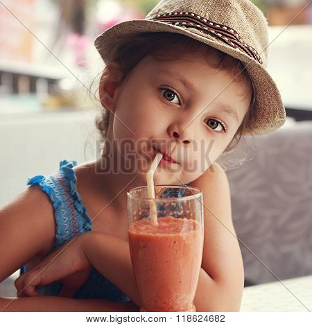 Fun Cute Kid Girl Drinking Healthy Smoothie Juice In Street Restaurant. Closeup Toned Portrait