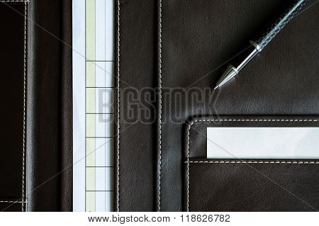 Brown Leather Folder With Note Paper And Pen
