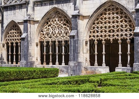 Batalha, Portugal - July, 2015: Intricate stonework on the Royal Cloister of the Batalha Abbey. Masterpiece of the Gothic and Manueline art. UNESCO World Heritage Site.