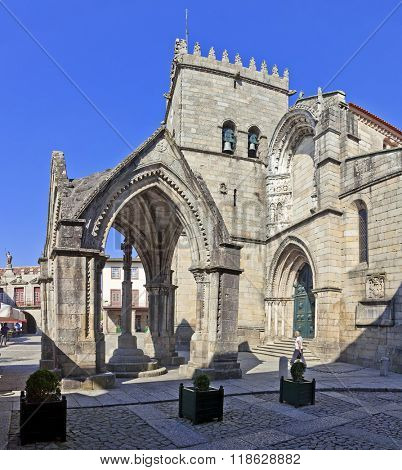 Guimaraes, Portugal - October, 2015: Salado Monument (Padrao do Salado) and Nossa Senhora da Oliveira Church in Oliveira Square. Guimaraes, Portugal. Unesco World Heritage Site.