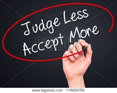 Man Hand Writing Judge Less Accept More With Black Marker On Visual Screen