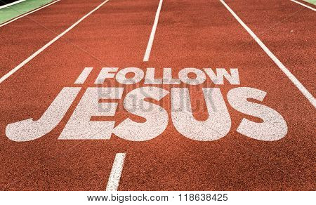 I Follow Jesus written on running track