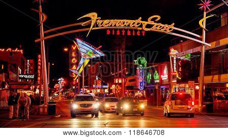 Neon Lights And Traffic At Fremont Street In Las Vegas