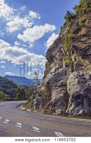 Road Turn Along Steep Rocky Cliff