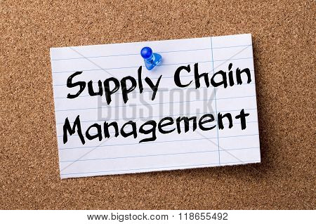Supply Chain Management Scm - Teared Note Paper Pinned On Bulletin Board
