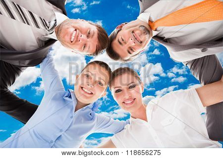 Huddle Of Happy Businesspeople