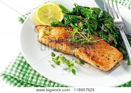 Grilled Salmon With Thyme, Lemon And Spinach, Vegetarian Low Carb Dish, Green And White Napkin On A