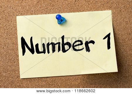 Number 1 - Adhesive Label Pinned On Bulletin Board
