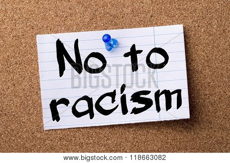 No To Racism - Teared Note Paper Pinned On Bulletin Board