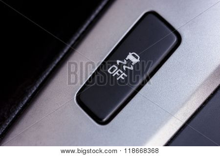 Slippery button. An image of a button for traction control in a modern car