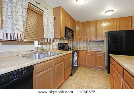 Light Wood Kitchen Woth Black Appliances
