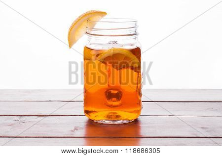 Hot Spiced Tea In Jar On Wooden Table