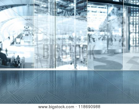 Abstract business background with global urban city lifestyle scene behind glass windows - blurred people, passengers, building and international airport hall