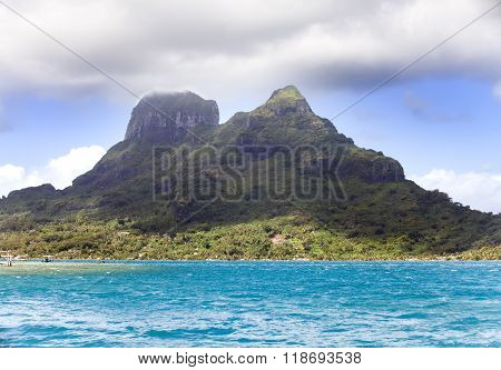 The blue sea and clouds over the mount Otemanu on Bora Bora island Polynesia.