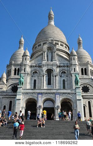 PARIS FRANCE - JULY 7: Sacre Coeur in summer day. Large medieval cathedral. Basilica of Sacred Heart. Popular landmark highest city point. July 7 2013 Paris France Europe.