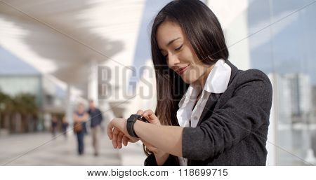 Attractive woman checking the time