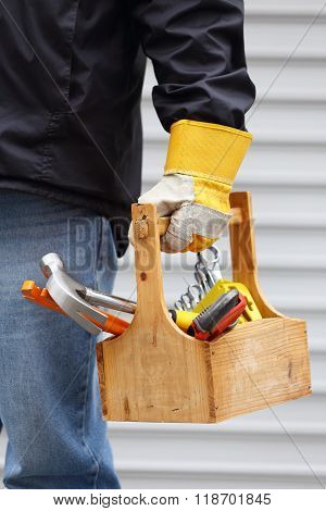 Worker Holding Toolbox