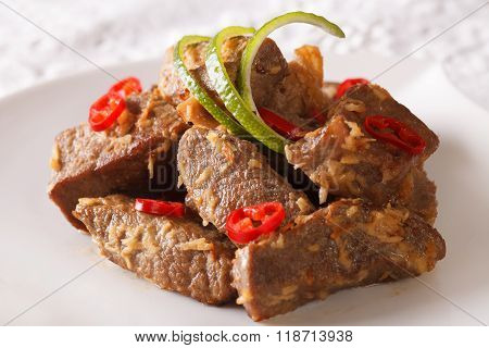 Indonesian Food: Beef Rendang Close-up. Horizontal