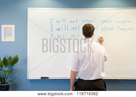 Office worker writing on whiteboard