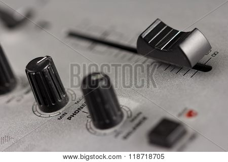 Knobs and fader of a DJ mixer