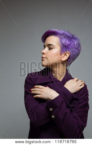 Violet-short-haired Woman Wearing A Violet Coat, Crossing Hands At Chest