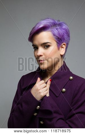 Violet-short-haired Girl Standing Front Of The Camera Wearing A Violet Coat.