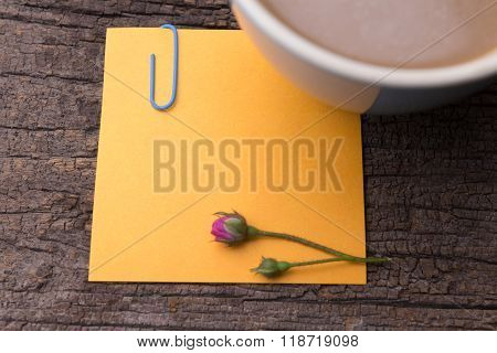 Close Up Of Grunge Note Paper On Wooden Background