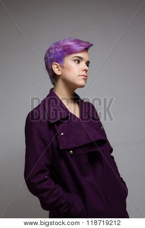 Violet-short-haired Woman Wearing A Violet Coat