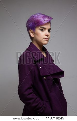 Violet-short-haired Woman Wearing A Violet Coat, Looking At Camera