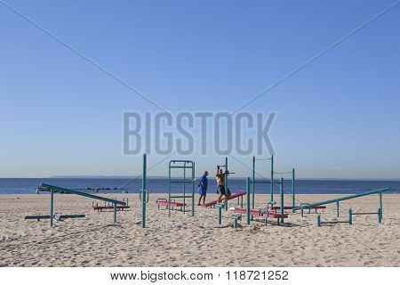 new york city 15 september 2015: older man works out on beach of coney island