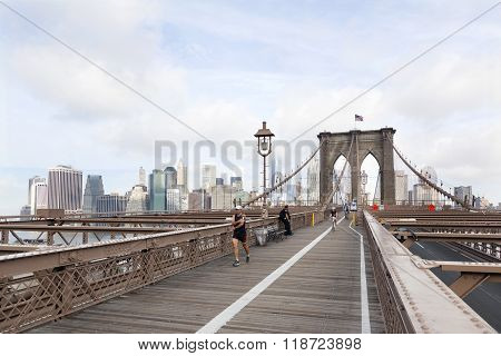People Engaged In Bike Run And Running On Brooklyn Bridge New York