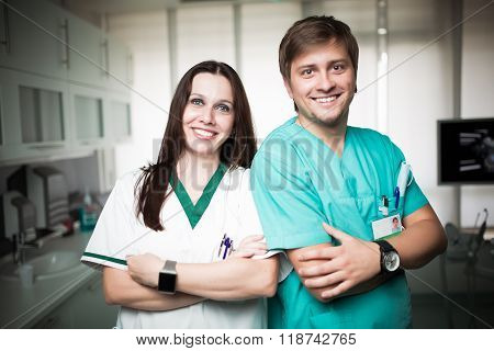 Young experienced doctors dentists standing along with nurse assistant