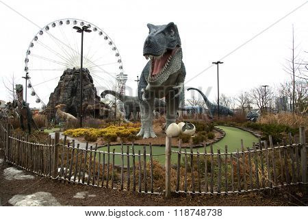 NIAGARA FALLS, CANADA-JANUARY 11, 2016:  Replica of a T-Rex dinosaur and others in a mini putt  golf at Niagara falls in Ontario, Canada