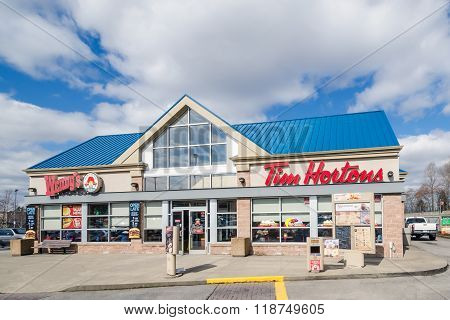 Vancouver, CANADA - APRIL 20, 2014: Entrance of Tim Hortons and Wendy's restaurant.