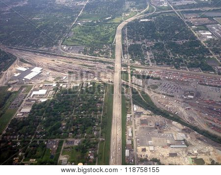A train yard sprawls across the flat landscape of Chicago, Illinois, one of America's largest rail hubs. ** Note: Visible grain at 100%, best at smaller sizes
