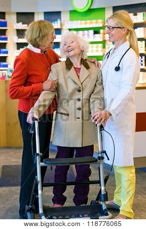 Happy Elderly Women With Walk Laughing With Doctor