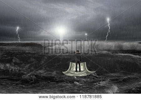Man Gazing Lighthouse On Money Boat In Ocean With Storm