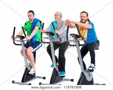 Female Senior Train With Fitness Machine And Using Phone