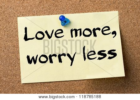 Love More, Worry Less - Adhesive Label Pinned On Bulletin Board