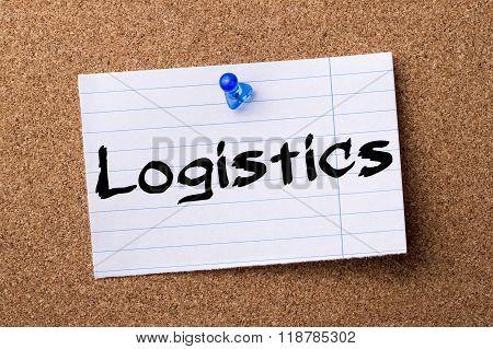 Logistics - Teared Note Paper Pinned On Bulletin Board