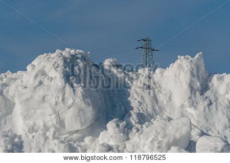 Power Line Behing Large Snow Pile