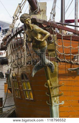 Mermaid figurehead on old sail ship. Vintage retro style.