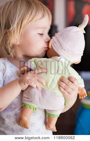 Baby Talking To Ear Doll
