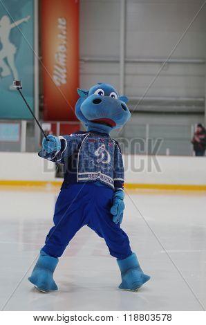 ST. PETERSBURG, RUSSIA - FEBRUARY 17, 2016: Dinamosaur, the mascot of the ice hockey club Dinamo Saint-Petersburg in the break during the women's ice hockey match against Biryusa Krasnoyarsk