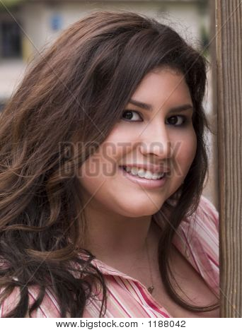 Portrati Plus-Size Hispanic Woman Outdoors Smiling